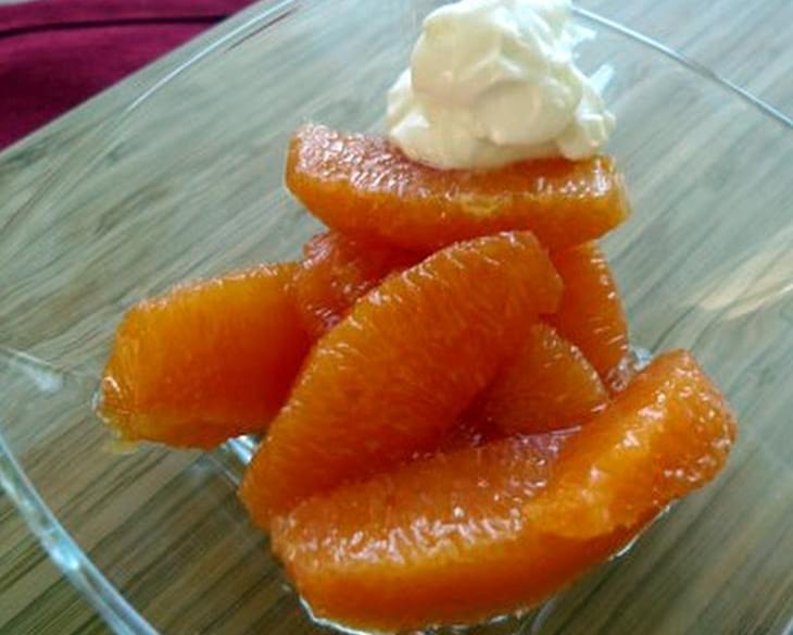 Oranges in Cardamom Syrup with Honey Whipped Cream
