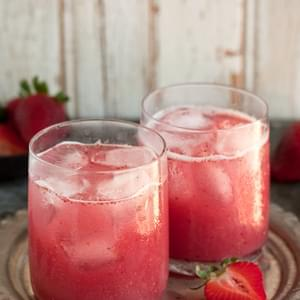 A Delectable Cocktail With Strawberries And Coconut Water