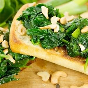 Vegetarian Crostini with Garlic Buttered Spinach, Lemon and Cashew Nuts