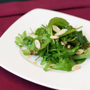 Mixed Green Salad with Pomegranate Dressing and Toasted Almonds