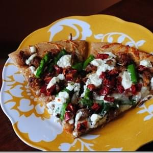 Spicy Sausage & Sundried Tomato Goat Cheese Pizza