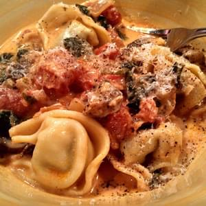 TORTELLONI WITH SPINACH TOMATO CREAM SAUCE