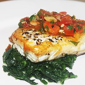 Pan Seared Halibut With Spinach and A Spicy Tomato Sauce