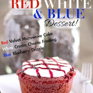 Healthy Single-Serving Red Velvet Microwave Cake with White Cream Cheese Frosting and Blue Blueberry Drizzle