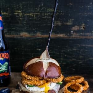 Chili Style Sweet Potato Black Bean Burgers w/Baked Cheddar Beer Onion Rings + Fried Eggs.