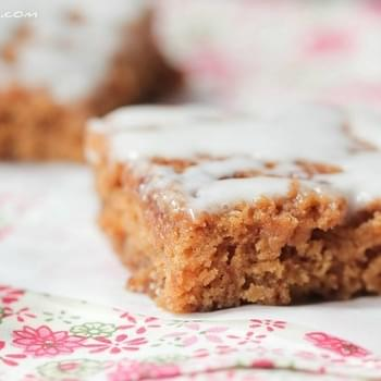 Cinnamon Roll Swirled Gingerbread Bars with Toffee Chips