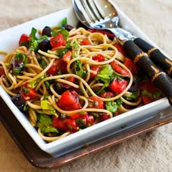 Whole What Spaghetti with No-Cook Sauce of Tomatoes, Arugula, Olives, and Capers