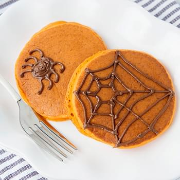 Pumpkin Pancakes with Chocolate Spiderwebs