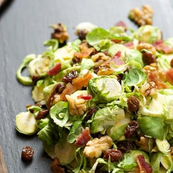 Shaved Brussels Sprout Salad with Raisins & Maple Dijon Vinaigrette