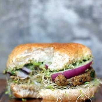 Spicy Sweet Potato Black Bean Burgers with avocado-cilantro crema + sprouts